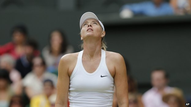 Maria Sharapova of Russia looks dejected after losing a point to Angelique Kerber of Germany during their women's singles match at the All England Lawn Tennis Championships in Wimbledon, London, Tuesday, July 1, 2014.
