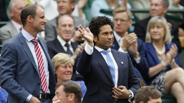 Former Indian cricketer Sachin Tendulkar, right, waves, with ex-England cricketer Andrew Strauss, left, from the Royal Box on centre court at the All England Lawn Tennis Championships in Wimbledon, London, Saturday, June 28, 2014