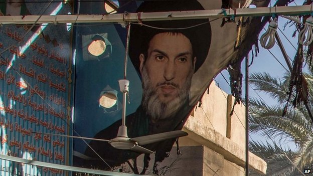 A burnt poster of Iraqi Shia cleric Mahmoud al-Sarkhi in Karbala (2 July 2014)