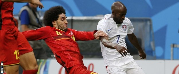 Marouane Fellaini tackles USA's DaMarcus Beasley