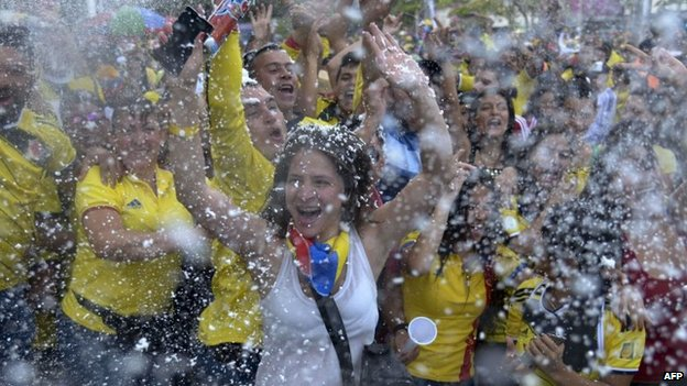 Colombian national team fans celebrate after winning the FIFA World Cup Round of 16 football match against Uruguay by 2 -0, in Medellin, Antioquia department, Colombia on 28 June, 2014