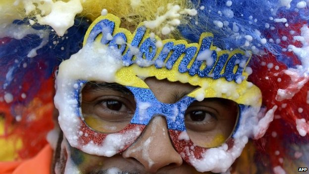 A fan of the Colombian national team celebrates after their victory over Uruguay