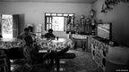 Players eat and watch football in their house in the village of the Kyikateje-Gaviao tribe