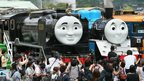 Thomas the Tank Engine (right) and Hiro (left) are seen at Senzu station in the town of Kawanehon, Japan