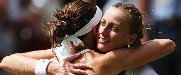 Lucie Safarova embraces Petra Kvitova