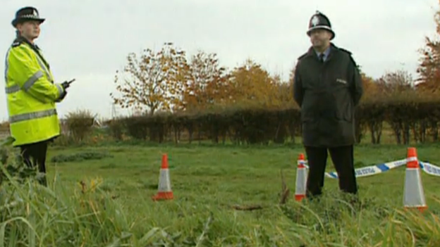 Police officers at site of body find