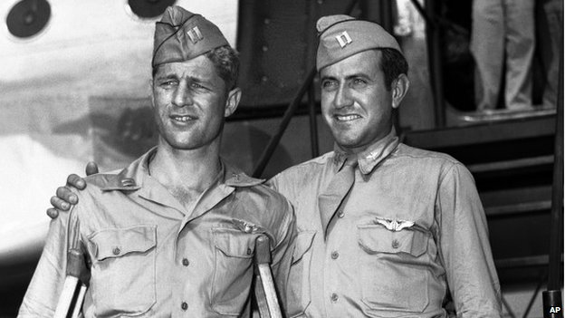 Capt. Louis Zamperini, right, of Torrance, Calif., and Capt. Fred Garrett of Riverside, Calif., arrive at Hamilton Air Field, later Hamilton Air Force Base, in Novato, California 3 October 1945