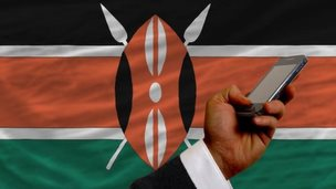 Mobile phone in front of Kenyan flag