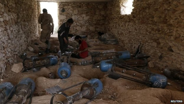 Free Syrian Army fighters prepare weapons