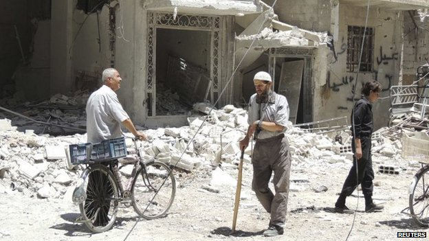 Residents view damage in a Damascus suburb