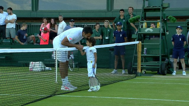 Nenad Zimonjic plays a quick rally with his son