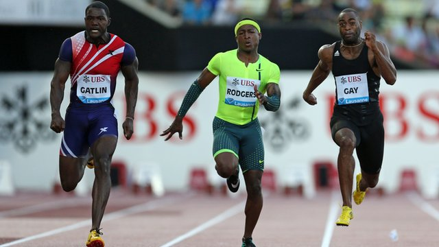 Justin Gatlin of USA (L), Michael Rodgers of USA (C) and Tyson Gay of USA compete in the Men's 100m race