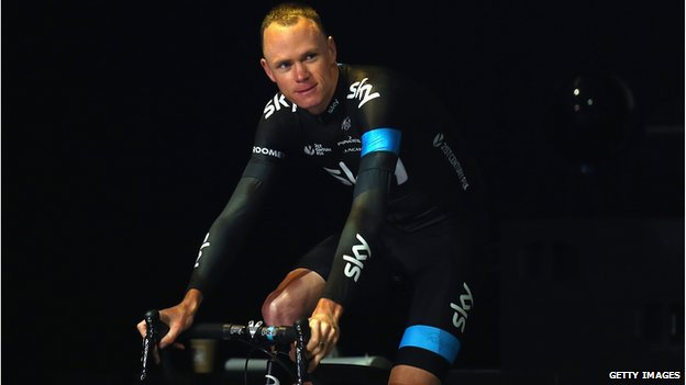 Defending Champion Chris Froome of Great Britain and Team SKY rides onto the stage during the 2014 Tour de France Team Presentation prior to the 2014 Le Tour de France Grand Depart on July 3, 2014 in Leeds, United Kingdom. (Photo by Bryn Lennon/Getty Images)