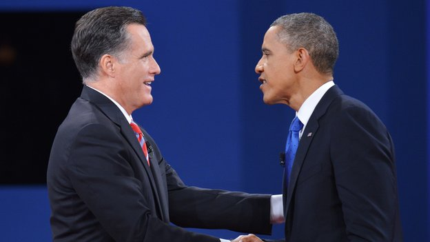 Mitt Romney and Barack Obama shake hands after a debate.