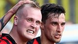 Goalscorer Jordan Owens is congratulated by Crusaders team-mate Declan Caddell