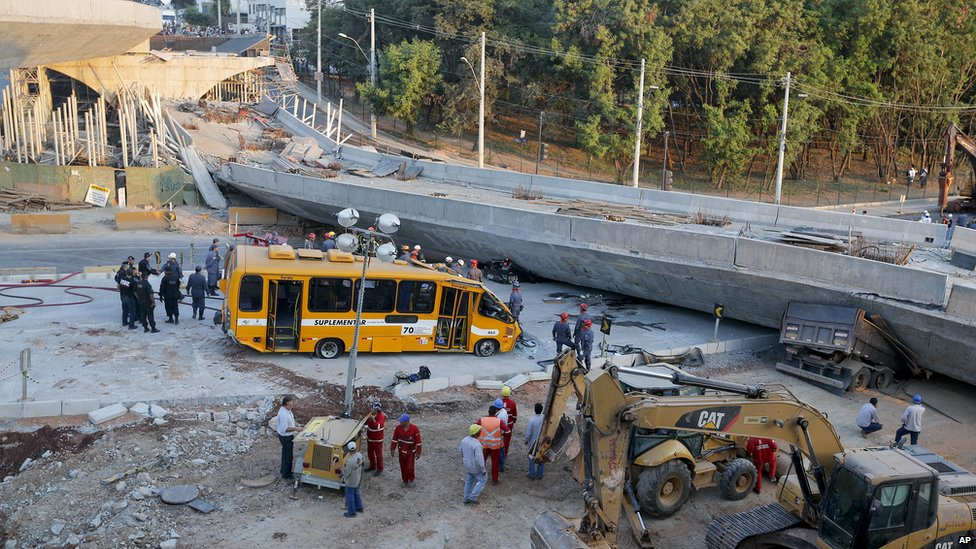 A bus sits damaged next to a bridge after it collapsed in Belo Horizonte, Brazil, on 3 July 2014.
