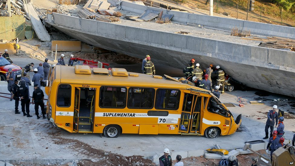 A bus sits damaged after a bridge collapsed in Belo Horizonte, Brazil, on 3 July 2014.