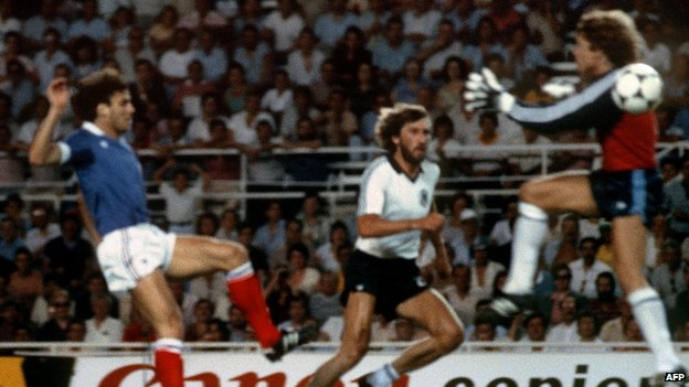 West German goalkeeper Harald (Toni) Schumacher (R) about to collide with French defender Patrick Battiston during World Cup semi-final. 8 July 1982