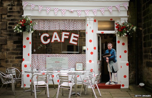 """Sid's Cafe"" from TV hit Last of the Summer Wine is decorated with King of the Mountains polka dots, in Holmfirth, West Yorkshire"