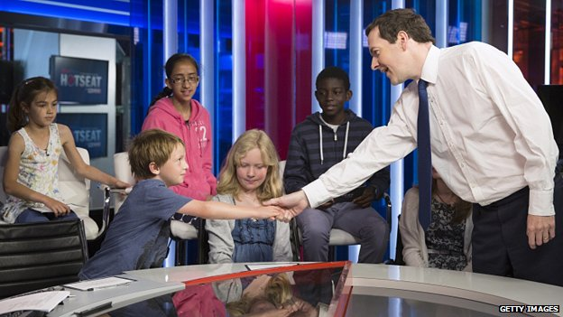 George Osborne shakes hands with Sam Raddings, seven, before being interviewed by readers of First News