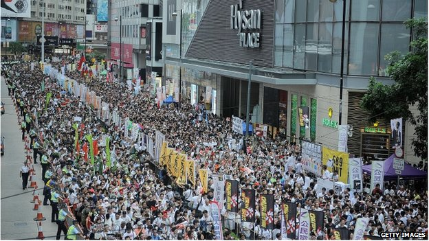 People march on a street during the annual pro-democracy protest on 1 July 2014 in Hong Kong.