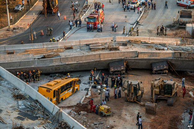 Rescue workers at the site where a bus, two trucks and a car were crushed in Belo Horizonte - 3 July 2014