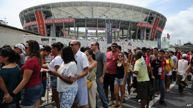 Football fans are seen outside of the Fonte Nova stadium in Salvador de Bahia, Brazil - 7 April 2013