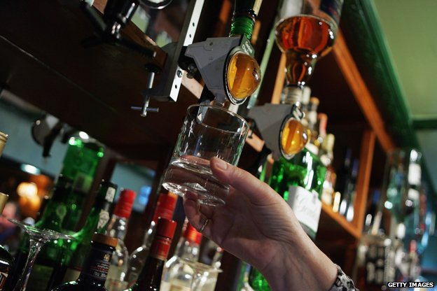 Woman serves alcohol in pub