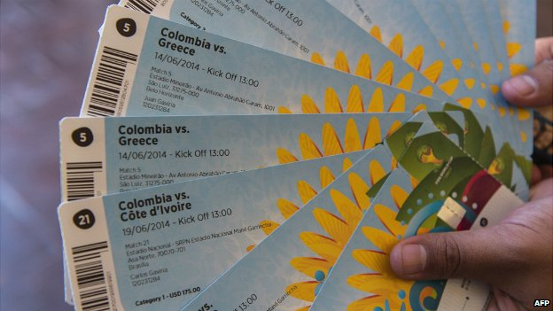 A football fan shows the tickets he bought for a World Cup match in Brazil - 18 April 2014