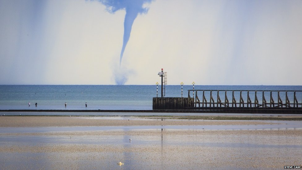 Tornado type wind whips up the water over the sea in Littlehampton, UK
