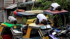 Muslim youths pray on top of motorcycle taxis