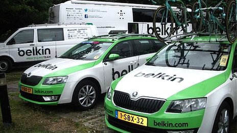 Two Belkin cars, one van, and the team coach