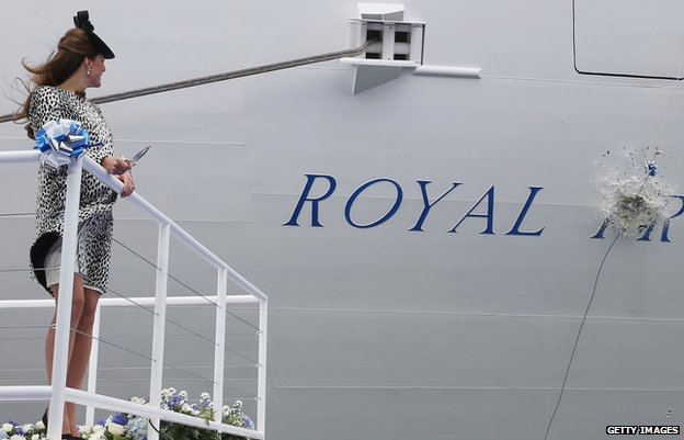 The Duchess of Cambridge watches a bottle of champagne smash against the Royal Princess ship