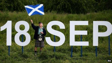 Ronnie Anderson from Edinburgh waves a Saltire flag