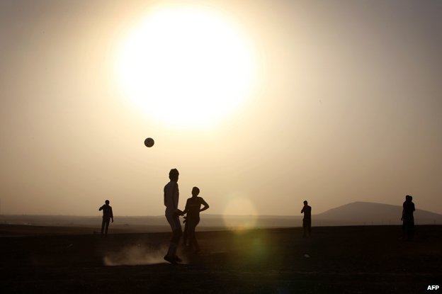 Displaced Iraqis playing football near Erbil