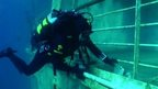 Italian police diver finds book on deck of Costa Concordia