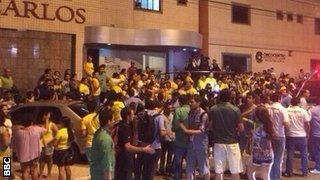 Fans gather outside of the hospital in Fortaleza