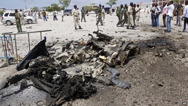 Wreckage of suicide car bomb in Mogadishu (5 July)
