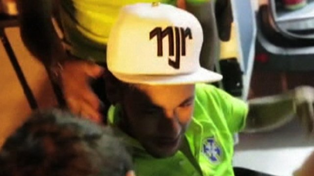 An emotional Neymar is consoled by team-mates
