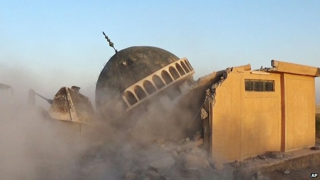 A bulldozer destroys Sunni Ahmed al-Rifai shrine and tomb in Mahlabiya district outside of Tal Afar, Iraq.