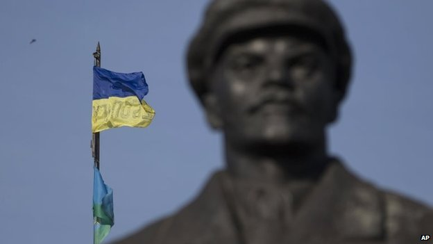A Ukrainian flag is seen over a government building in the city of Sloviansk, Donetsk Region, eastern Ukraine Saturday, July 5