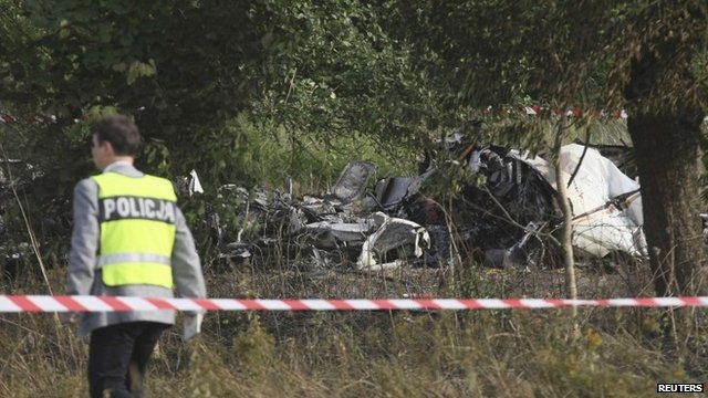 Plane wreckage and policeman