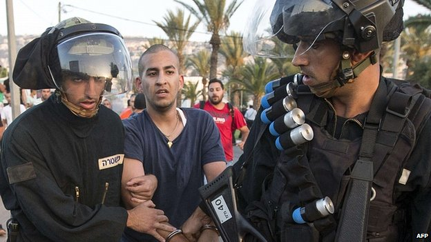 Israeli riot police detain Palestinian protester during clashes in Arab Israeli city of Arara, north of Israel