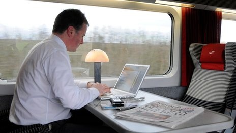 A train commuter using Internet