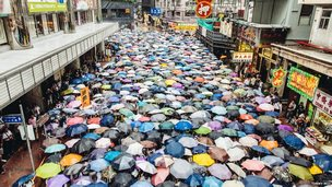 Protesters under umbrellas in Hong Kong.