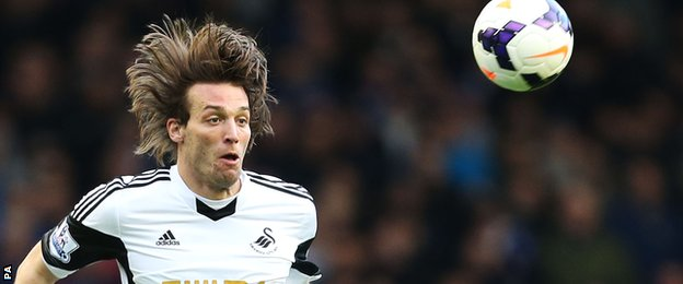 Michu heads the ball for Swansea last season