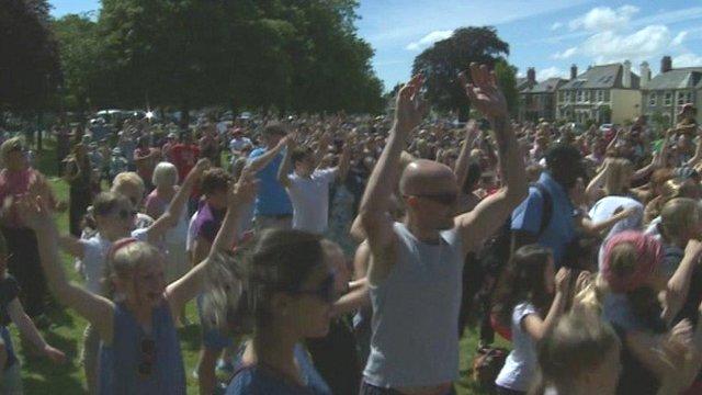 Volunteers do the Gangnam Style dance