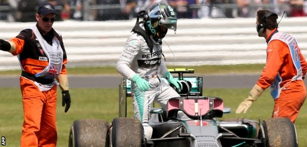 Nico Rosberg climbs out of his car