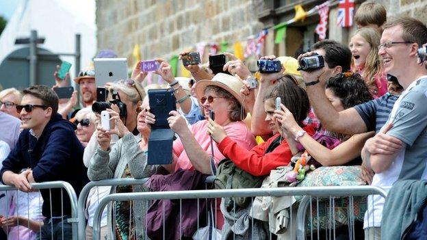 People taking photos of Tour de France race 2014