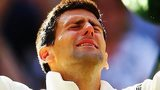 Novak Djokovic shuts his eyes and looks to the heavens as he celebrates beating Roger Federer
